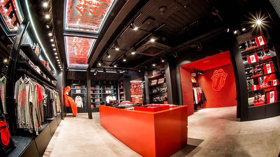 "There is an exclusive and curated mix of collections and collaborations for fans of all ages. The store also introduces ""Stones Red,"" the official color from Pantone, which is seen in design elements, as well as an exclusive apparel and accessories collection."