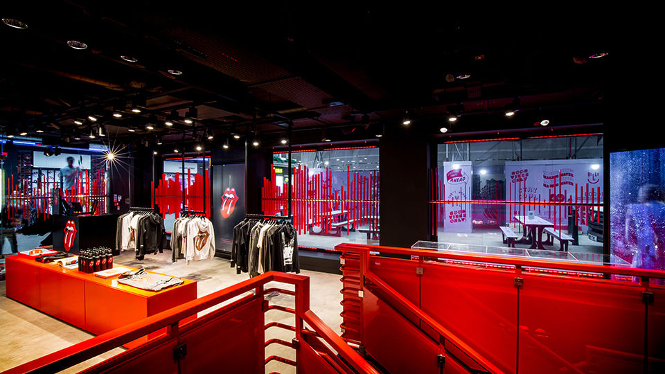"The store's windows feature a world first soundwave installation, taken from the opening to the 1966 hit track ""Paint It Black."" The audio of the beginning of the  song is visualised as a soundwave and reinterpreted into a striking red metal sculpture."