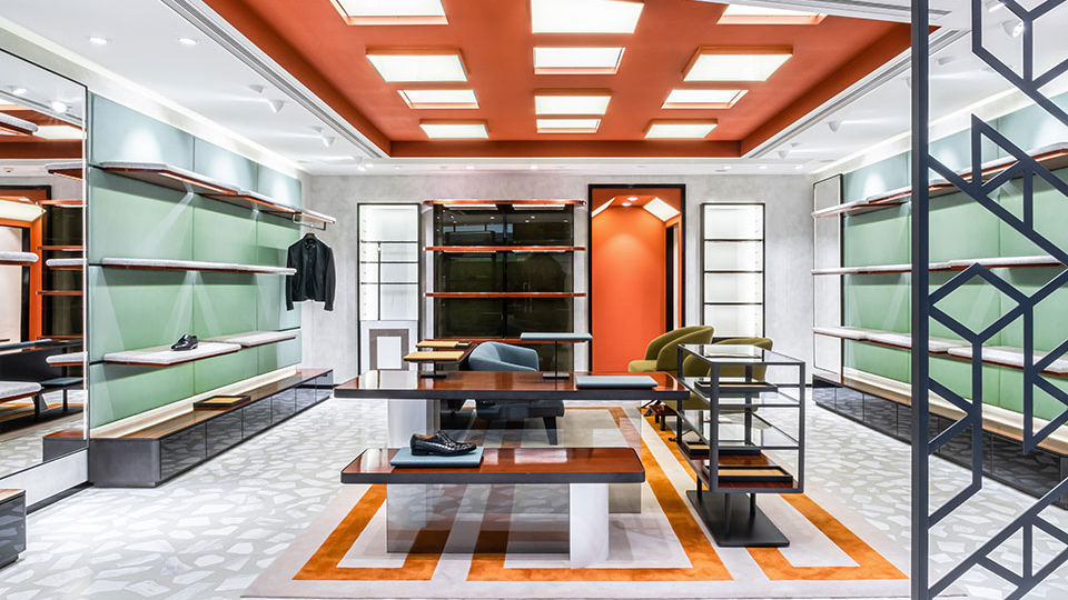 The studio opted to use flaming orange to reference the major colors of Bologna, Italy's buildings. The bright, customized fixtures and furnishings evoke a bright energy.