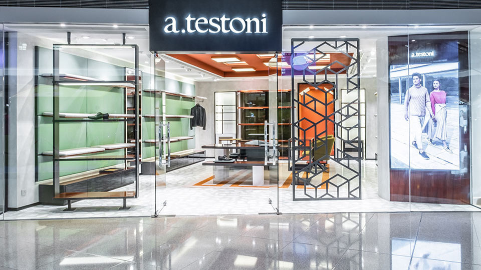 Stefano Tordiglione Design Ltd. (ST Design) created a colorful interior with geometric shapes to highlight the brand identity for a. testoni.
