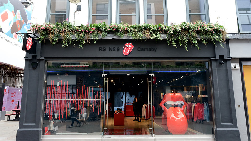 "Legendary rock band The Rolling Stones opened its world-first flagship store, RS No. 9 Carnaby at 9 Carnaby Street in London's Soho. The new store, created in partnership with Bravado, Universal Music Group's merchandise and brand management company, features all of the hallmarks of the iconic band and includes exclusive new fashion label ""RS No. 9 Carnaby."""