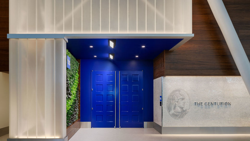 The new lounge experience features bold blue doors and a branded façade mosaic wall that was inspired by NYC subway murals.