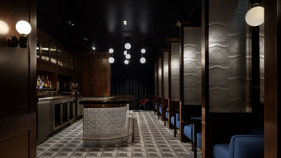 """An intimate speakeasy setting, inspired by 1920s design, offers artisan coffee by day and cocktails by night. A hidden entrance door is marked with """"1850,"""" signifying the name of the lounge and giving a nod to the year American Express was founded."""
