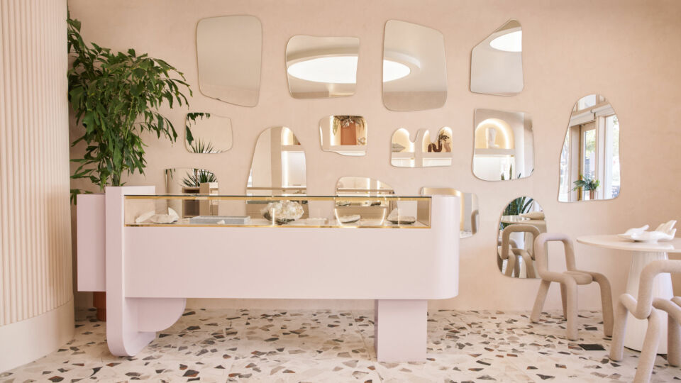 The space incorporates unexpected and playful design elements like these segmented mirrors.