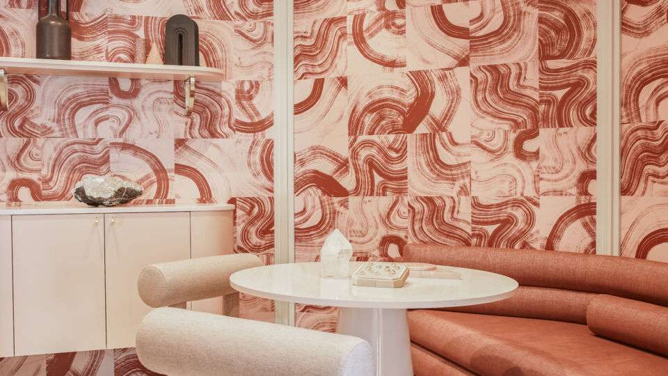 The interior reflects the brand's color palette and hues of pinks, rusts and creams.