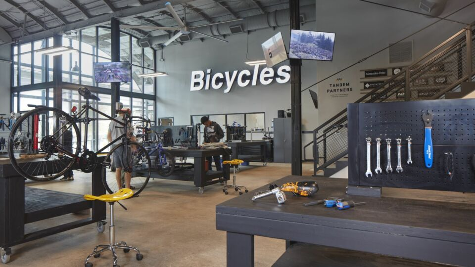 Bearings Bike Work's new home features an industrial theme with additional workstations and breakout areas for training and mentorship, while maintaining the rich context and fabric of the neighborhood.