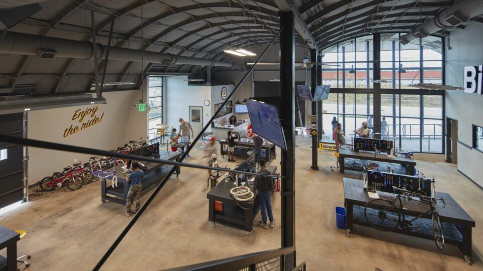 Surrounding the workstations are workshop spaces for more in-depth teaching opportunities and storage for bikes, tools and equipment. A second-floor mezzanine level addition will be equipped with added offices for employees.