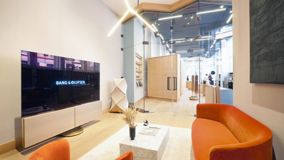 """An acoustically designed """"listening room"""" offers a residential setting, giving customers an immersive experience showing how Bang & Olufsen's products work seamlessly together."""