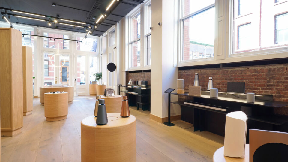The team imported German wood flooring for the space. Exposed brick and sawtooth walls add dimension and texture to the store.
