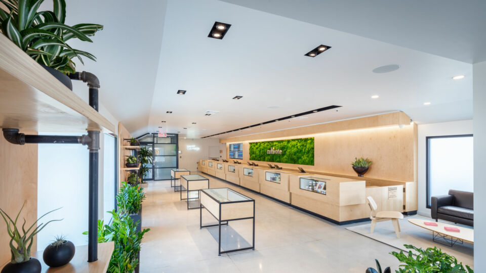 The view from the dispensary exit highlights the continuous open layout of product display, client services and a consultation area with seating.