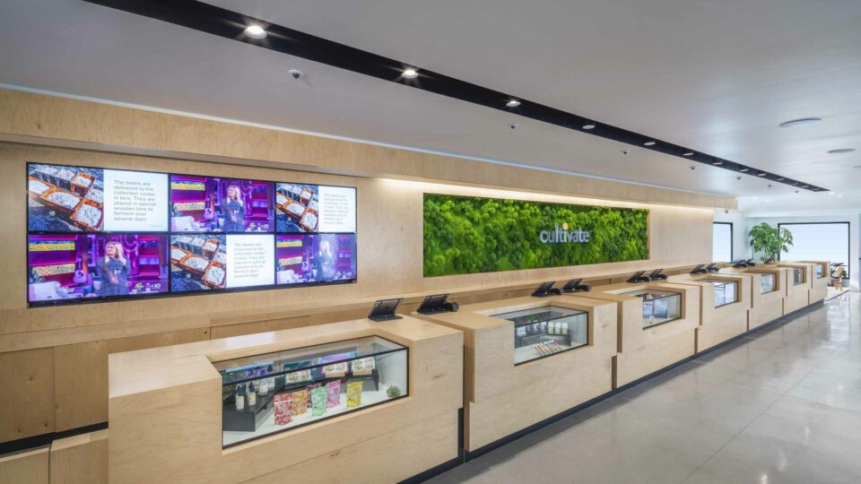 The client services area incorporates digital displays to share product updates and news.