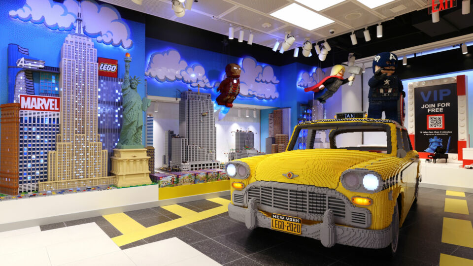 A full-size LEGO taxi sits in the front window ready for visitors to take a ride. (Photo by Cindy Ord/Getty Images)
