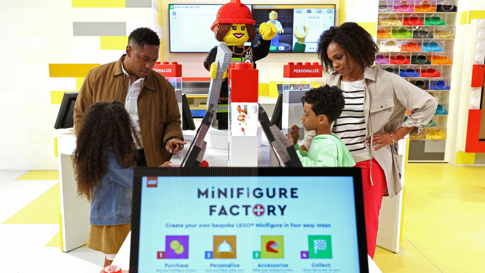 Minifigure Factory: Touchscreen stations allow visitors to create their own print-on-demand minifigure. (Photo by Cindy Ord/Getty Images)
