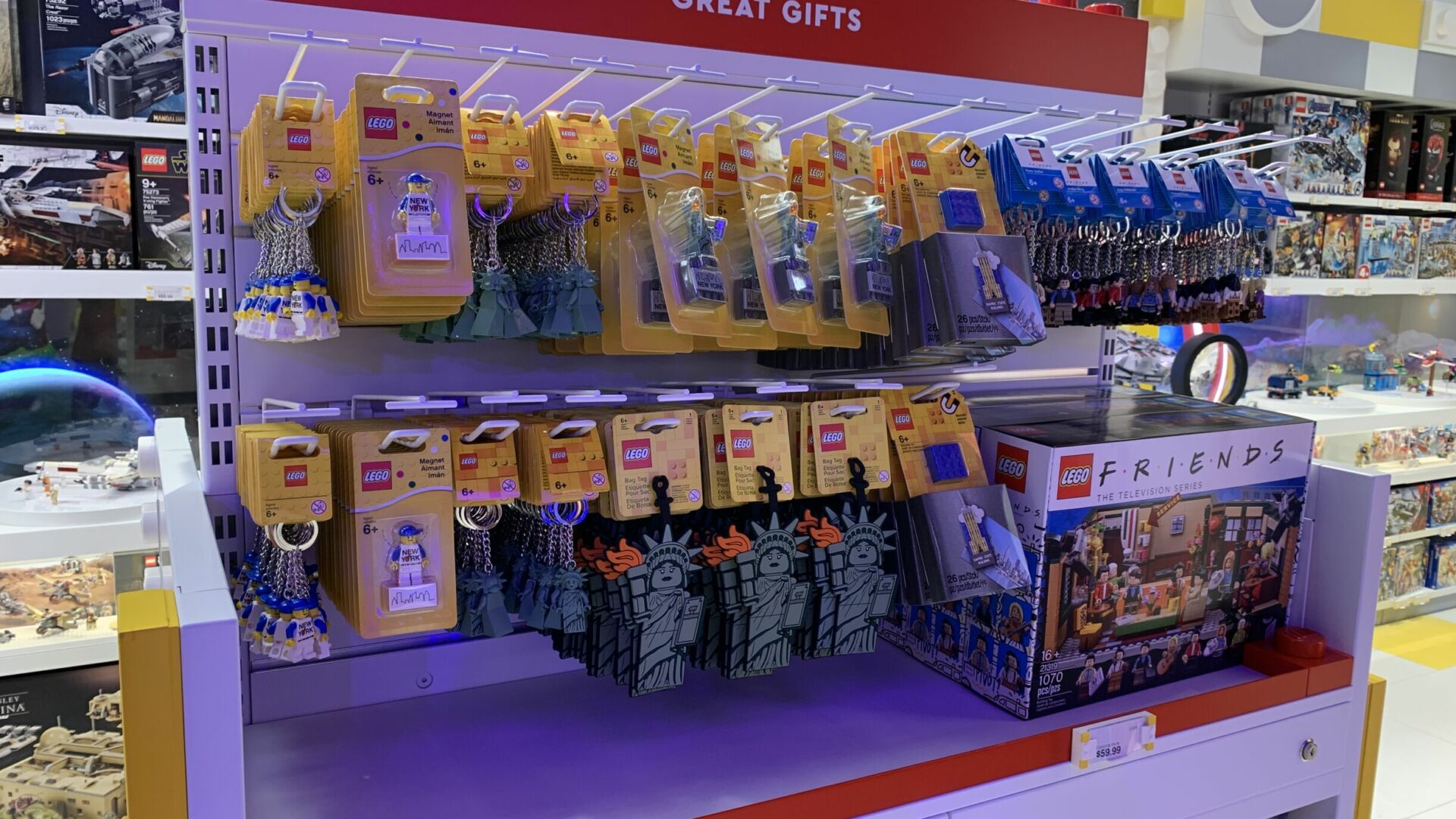 Impulse items near the register include LEGO classics and location-specific offerings.