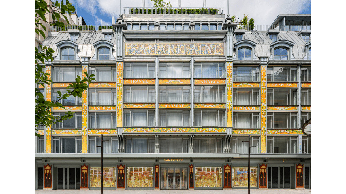 The famed Art Nouveau facade designed by Frantz Jourdain. Jourdain used a metal framework to save space when constructing the building  but to soften the look added enameled Volvic lava decorations designed by his son.