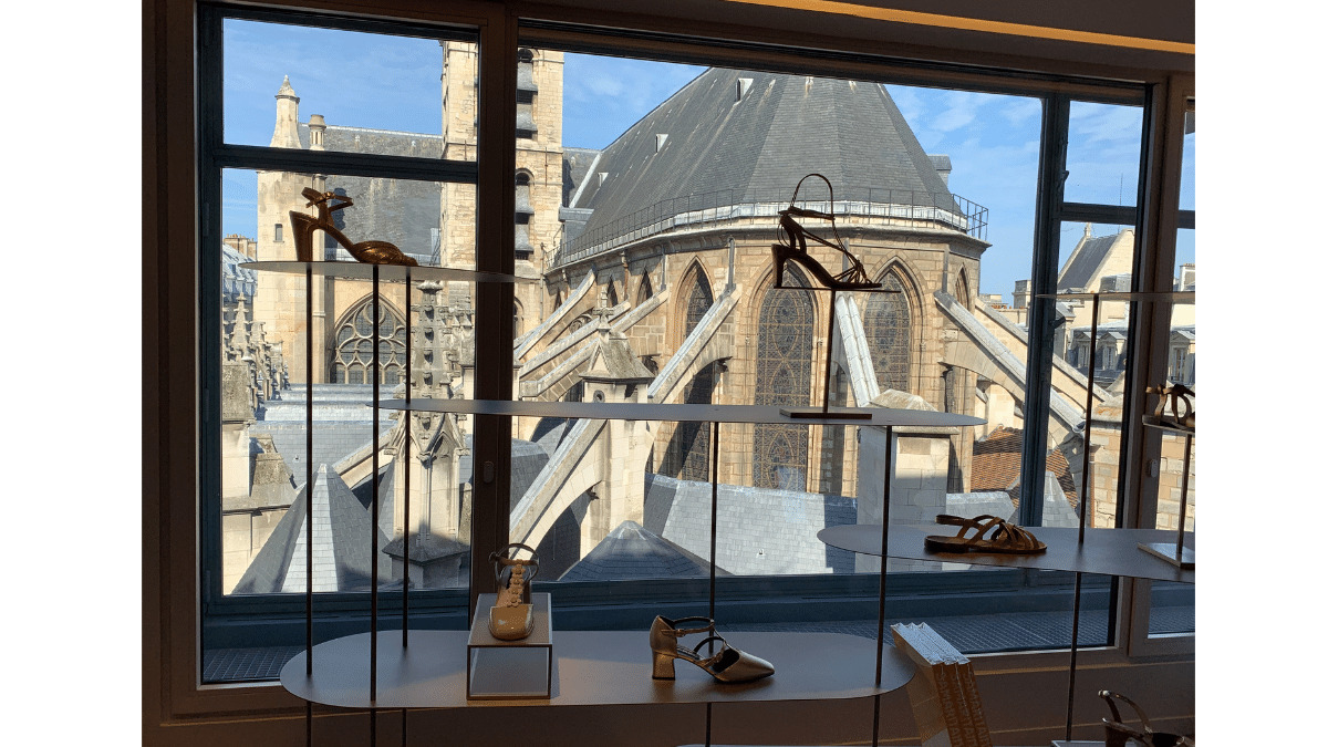 The women's shoe department on the fifth floor offers an often overlooked view of the oldest church in Paris, used by royalty who lived just on the other side at the Louvre palace.