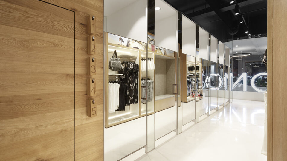 Changing rooms are also concealed behind mirrored doors.