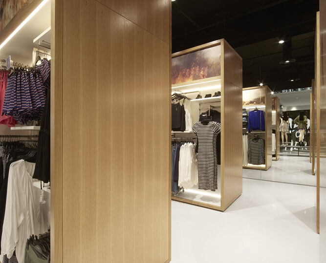 Taking inspiration from the layout of supermarket aisles, Landini Associates found that presenting merchandise in wardrobe-like display units actually created space for 50% more product on the sales floor.