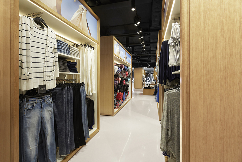 """Landini Associates designed the Glassons display units to frame individual collections, allowing various looks to be styled within each """"wardrobe."""""""